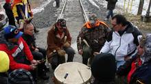 Drummers play on the tracks as people from the Aamjiwnaang First Nation and supporters gather for a meeting with officials during their blockade of the CN St. Clair spur line. (DAVE CHIDLEY/THE CANADIAN PRESS)