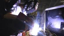 Seventeen year old Alex Haraga, a grade 11 student at Richmond Green Secondary School, tries his hand at welding while attending the Future Building 2012 show in Toronto on March 27 2012. (FRED LUM/THE GLOBE AND MAIL)