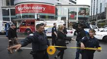 Police close off an area at the Toronto Eaton Centre shopping mall in Toronto, June 2, 2012. (MARK BLINCH/REUTERS)