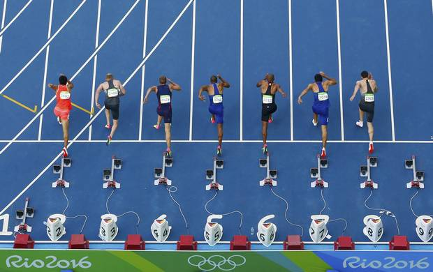 Athletes race off from the starting block