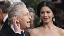 Michael Douglas and Catherine Zeta-Jones arrive at the 68th annual Golden Globe Awards in Beverly Hills, California, in this January 16, 2011 file photograph. Zeta-Jones sought treatment for bipolar disorder after dealing with the stress of husband Douglas's battle with advanced throat cancer, her representative said on April 13, 2011. (MARIO ANZUONI/Mario Anzuoni/REUTERS)