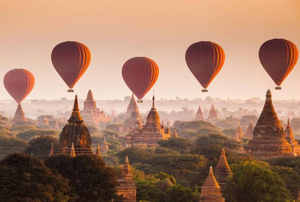 Bagan, Myanmar's 11th century archaeological zone of more than 2,000 ancient pagodas gives rise to an iconic photo opportunity when hot-air balloons provide wide-angle views of its flat plain.