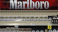 In this Wednesday, July 17, 2013, file photo, Marlboro cigarettes are on display in a CVS store in Pittsburgh. The nation's second-largest drugstore chain says it will phase out cigarettes, cigars and chewing tobacco by Oct. 1 as it continues to focus more on health care. (Gene J. Puskar/AP)