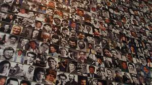 The Journalists Memorial in Washington's Newseum includes more than 1,800 names and hundreds of photos of journalists who died covering conflict.