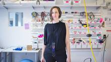 Kate Hartman, an artist and assistant professor at OCAD University in Toronto, is wearing a necklace made with a 'Nudgeables' accessory kit. When two people wear the wireless radio transceiver accessories they are able to nudge each other from a distance. (JENNIFER ROBERTS FOR THE GLOBE AND MAIL)