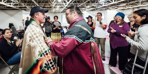 Traditional knowledge keeper Paul Carl, right, participates in a blanket ceremony in Kingston with with Geoff Green, leader of the Canada C3 expedition.