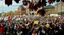 Thousands of striking Ontario teachers gather outside the provincial legislature at Queen's Park to protest the government's educational policies in November of 1997. (Andy Clark/Andy Clark/Reuters)