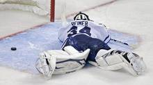 Toronto Maple Leafs goalie James Reimer lays on the ice after getting beat on the game winning goal by Boston Bruins center Patrice Bergeron during overtime in Game 7 of their NHL hockey Stanley Cup playoff series in Boston, Monday, May 13, 2013. (Associated Press)