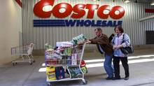 Shoppers leave a Costco outlet in New York on April 30, 2010. (SUZANNE DECHILLO/NYT)