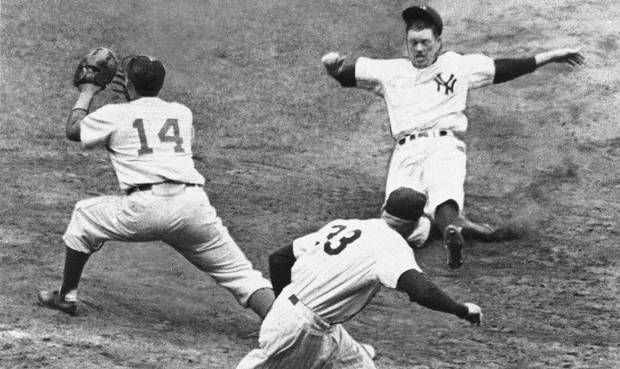 In this Oct. 4, 1955, file photo, New York Yankees' Gil McDougald gets back to first too late to avoid being doubled off first base after Brooklyn Dodgers left fielder Sandy Amoros made a catch of a ball hit by Yogi Berra during a World Series baseball game at Yankee Stadium in New York. McDougald, an All-Star infielder who helped the Yankees win five World Series championships during the 1950s, has died. He was 82. The Yankees released a statement Monday, Nov. 29, 2010, saying McDougald died Sunday of prostate cancer at his home in Wall Township, N.J.