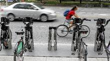 A cyclist uses the bike lanes on Jarvis Street in downtown Toronto in July, 2011. (Fernando Morales/The Globe and Mail/Fernando Morales/The Globe and M)