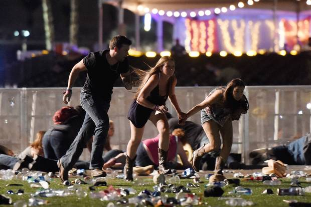 People run from the Route 91 Harvest country music festival in Las Vegas on Oct. 1, 2017, after gunfire broke out.