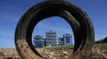 A tire is seen on a site set aside for future construction, next to office buildings in the Andalusian capital of Seville on Oct. 4, 2012. (Marcelo del Pozo/REUTERS)