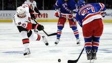 New York Rangers Ryan McDonagh (R) blocks a shot by Ottawa Senators Erik Karlsson during the second period of Game 2 of their NHL Eastern Conference quarter-final playoff game at Madison Square Garden in New York April 14, 2012. (Ray Stubblebine/Reuters/Ray Stubblebine/Reuters)