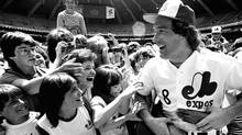 FILE - In this June 24, 1983 file photo, Montreal Expos catcher Gary Carter is mobbed by admiring fans at camera day prior to a baseball game against the Pittsburgh Pirates in Montreal. (The Canadian Press)