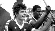 Canadian national soccer team players Paul James (left) and Randy Samuel celebrate the team's 2-1 win over Honduras in St. John's, Nfld. in this 1985 file photo. The win sent Canada to the 1986 FIFA World Cup in Mexico, the nation's first and only appearance in the coveted tournament.(CP PICTURE ARCHIVE/Michael Creagan) (MICHEAL CREAGAN)
