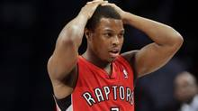 Toronto Raptors' Kyle Lowry reacts during the first half of Game 6 of the opening-round NBA basketball playoff series against the Brooklyn Nets, Friday, May 2, 2014, in New York. (AP)
