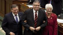 Newly elected Speaker of the Ontario Legislature, Liberal MPP Dave Levac is guided toward the Speaker's chair by fellow MPPs Jerry Ouellette and Liz Sandals at Queen's Park on Nov. 21 2011. (Moe Doiron/The Globe and Mail/Moe Doiron/The Globe and Mail)