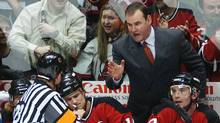 Coach Pat Burns talks to referee Brad Watson, left, during his tenure as coach of the New Jersey Devils in April, 2004. (BILL KOSTROUN/Bill Kostroun/The Associated Press)