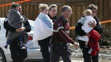 Young children are reunited with their parents after a shooting incident at a day care April 5, 2013 in Gatineau, Quebec. (Dave Chan for The Globe and Mail.)