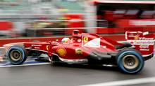 Ferrari Formula One driver Fernando Alonso of Spain drives during the first practice session of the Canadian F1 Grand Prix at the Circuit Gilles Villeneuve in Montreal June 7, 2013. Next year, Kimi Räikkönen will join Alonso at Ferrari. (CHRIS WATTIE/REUTERS)