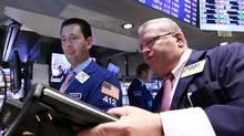 Traders work on the floor of the New York Stock Exchange, August 23, 2012 (Brendan McDermid/Reuters)
