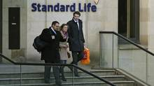 Workers leave the Standard Life House in Edinburgh, Scotland February 27, 2014. Insurance and pensions heavyweight Standard Life became the first major company to warn it could move partly out of Scotland if Scots split from the United Kingdom, fuelling a political row over the financial impact of independence. (RUSSELL CHEYNE/REUTERS)