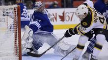 Boston Bruins left wing Chris Bourque scores on Toronto Maple Leafs goalie James Reimer during first period NHL action in Toronto on Saturday, Feb. 2, 2013. (Frank Gunn/THE CANADIAN PRESS)