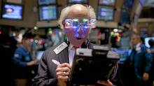 A trader works on the floor of the New York Stock Exchange in New York, U.S., on Friday, Dec. 30, 2011. Stocks that analysts praise at the start of the year often turn in lacklustre performances, a researcher has found. (Jin Lee/Bloomberg/Jin Lee/Bloomberg)