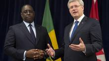 Canadian Prime Minister Stephen Harper delivers some remarks as Senegal President Macky Sall looks on prior to a bilateral meeting at the United Nations and New York City, Wednesday Sept. 25, 2013. (Adrian Wyld/THE CANADIAN PRESS)