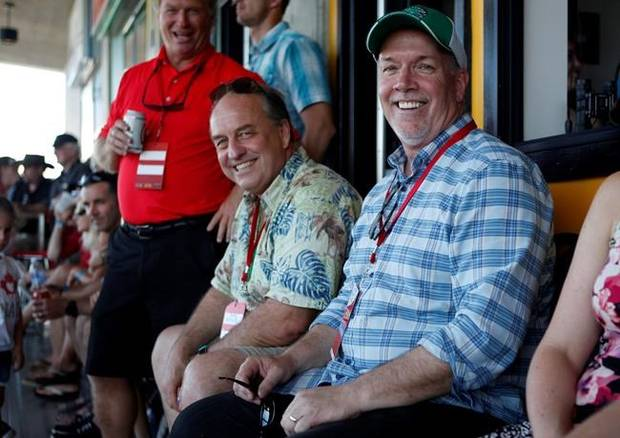 B.C. Green party leader Andrew Weaver and B.C. NDP leader John Horgan take in the final match between Team Canada and New Zealand during cup final action at the HSBC Canada Women's Sevens rugby event in Langford, B.C., on Sunday, May 28, 2017.