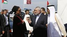 The Emir of Qatar Sheikh Hamad bin Khalifa al-Thani (R), his wife Sheikha Mozah bint Nasser al-Missned (L), Hamas Prime Minister Ismail Haniyeh (2nd R) and his wife Amal Haniyeh arrive at a cornerstone laying ceremony for Hamad, a new residential neighbourhood in Khan Younis in the southern Gaza Strip October 23, 2012. The Emir of Qatar embraced the Hamas leadership of Gaza on Tuesday with an official visit breaking the isolation of the militant Palestinian Islamist movement, to the dismay of Israel and rival, Western-backed Palestinian leaders in the West Bank. (MOHAMMED SALEM/REUTERS)