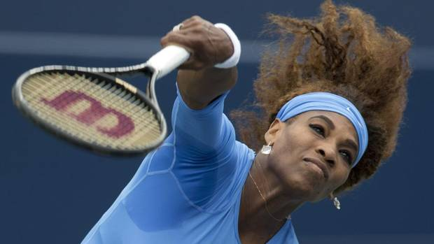 Serena Williams of the U.S. serves to Sorana Cirstea of Romania during their women's final tennis match of the Rogers Cup tennis tournament in Toronto, August 11, 2013. (MARK BLINCH/REUTERS)