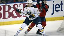 Buffalo Sabres Tyler Myers (57) and Florida Panthers' Tomas Fleischmann chase the puck during the first period of an NHL hockey game in Sunrise, Fla., Friday, Oct. 25, 2013. (J PAT CARTER/AP)