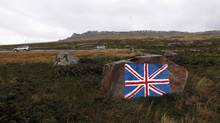 A rock painted with the Union Jack flag, is seen near Port Stanley March 11, 2012. (MARCOS BRINDICCI/REUTERS/MARCOS BRINDICCI/REUTERS)