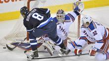 New York Rangers goaltender Henrik Lundqvist makes a save on the Winnipeg Jets Alexander Burmistrov in Winnipeg, March 28, 2012. (Fred Greenslade/Reuters/Fred Greenslade/Reuters)
