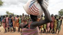 A woman from the Dadinga tribe carries food aid distributed by World Food Program (WFP) staff in the village of Lauro in Budy county in Eastern Equatoria State, south Sudan, April 2, 2010. (Goran Tomasevic/Reuters/Goran Tomasevic/Reuters)