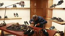 A shoemaker works at the largest Louis Vuitton store in China, in Shanghai, in this July 17, 2012, file photo. (ALY SONG/REUTERS)
