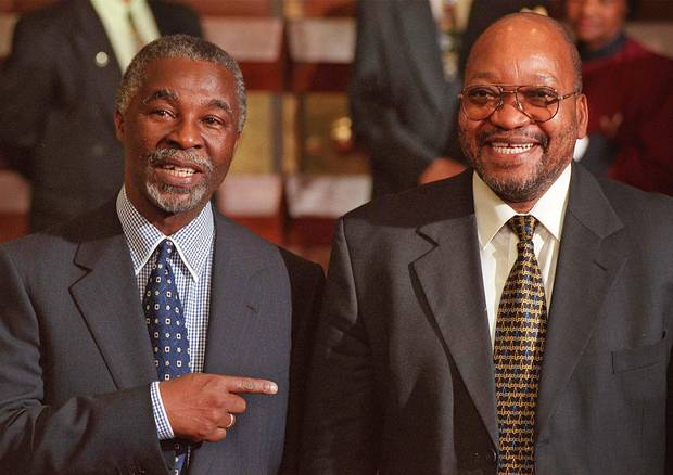 Former South African president Thabo Mbeki, left, shares a laugh with his then-deputy president in Cape Town, South Africa, in June, 1999.