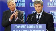 Prime Minister Stephen Harper makes an announcement with Mayor David Miller at the Toronto Reference Library on Oct. 16, 2009. (MARK BLINCH)