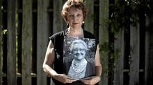 Joyce Western poses with a portrait of her late mother, Marjorie Howse, in St. Catherines, Ont. Sunday, July 3, 2011. Ms. Howse died after a C. difficile infection. (Darren Calabrese for The Globe and Mail)