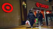 People shop at a Target store during Black Friday sales in the Brooklyn borough of New York in this file photo taken November 29, 2013. (ERIC THAYER/REUTERS)