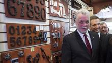 Liberal leader Philippe Couillard visits a hardware store during a campaign stop Monday, March 24, 2014 in Sherbrooke, Que. (Paul Chiasson/THE CANADIAN PRESS)