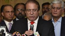 Pakistan's Prime Minister Nawaz Sharif speaks with the media during a new conference in New Delhi on May 27, 2014. (STRINGER/INDIA/REUTERS)