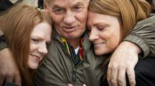 Ivan Henry hugs his two daughters Tanya, left, and Kari after he was acquitted of eight counts of rape from after a conviction in 1983 which sent him to prison for 27 years. (John Lehmann/The Globe and Mail)