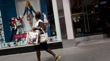 A woman walks past an Aeropostale store in Times Square in New York on July 27. (ANDREW BURTON/REUTERS)