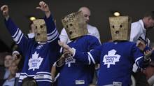 Toronto Maple Leafs fans wear paper bags on their heads during the third period of their NHL hockey game against the New York Islanders in Toronto March 20, 2012. (Reuters)