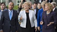 Quebec Premier Pauline Marois, centre, chats with Massachussetts Governor Deval L. Patrick, left, and New Hampshire Governor Margaret Wood Hassan following the official picture at the 37th annual conference of the New England Governors and Eastern Premiers on Sept. 8, 2013 in La Malbaie, Que. (Jacques Boissinot/The Canadian Press)