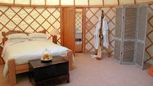 A luxury yurt room at Priory Bay Hotel on the Isle of Wight, UK.