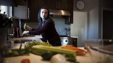 Carla Ladeira at home in Vancouver, Nov. 19, 2013. She was diagnosed with osteoporosis at age 41 and is focusing on getting her requirements met from food sources instead of supplements. (Rafal Gerszak for The Globe and Mail)